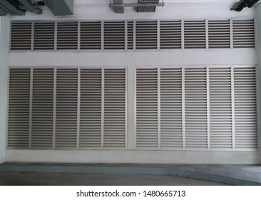 Aluminium louver on facade of  ีีunderground parking for ventilation and lighting with horizontal pattern. Exterior design. Energy saving concept.