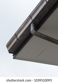 Aluminium rain gutter on the roof background