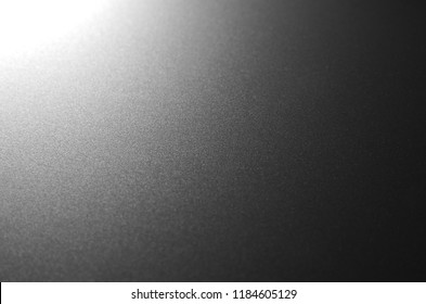 Aluminium surface in dark tone. chrome steel with reflection of light. selective focus.