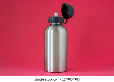 Aluminium water bottle on a red background