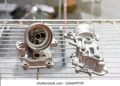 aluminum alloy exhaust body or engine part of automobile vehicle or Lawn mower before machining made from high pressure die casting process on rack