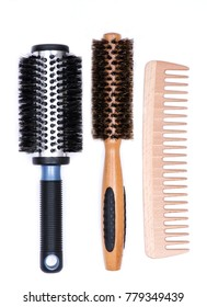 Aluminum barrel round, natural bamboo hairbrushes with wild boar bristles and wooden comb isolated on white background