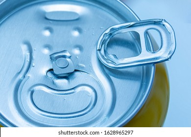 Aluminum can. closeup of a broken key. Defect, substandard, defective in production. Dissatisfaction, deception, disappointment, alcohol addiction.
