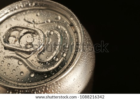 Aluminum can of cold beer on dark background, closeup