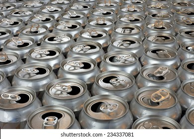 aluminum can recycling close up view tops of empty cans in symmetrical rows, landscape horizontal view