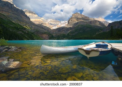 Aluminum canoe and a boat on a mountain lake