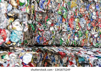 Aluminum Cans in Extruded Form at a Processing Plant. Cans Press Special Machines. Close Up Shoot. Kyiv, Ukraine, Kyivmyskvtorresursy Plant 01.10.2018