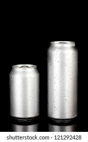 Aluminum cans with water drops isolated on black