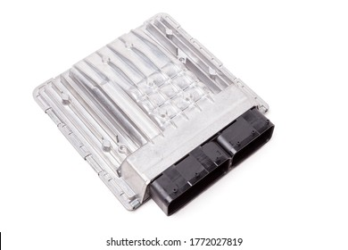 Aluminum car engine control unit with metal elements on white background is connecting center of various subsystems, assemblies and assemblies for replacement during repair or sale at an auto-parsing.