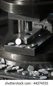 Aluminum circles on a press machine