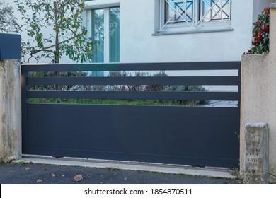 Aluminum design grey metal gate of modern suburb house entrance