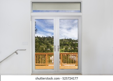 Aluminum door with double glass window and wooden deck.