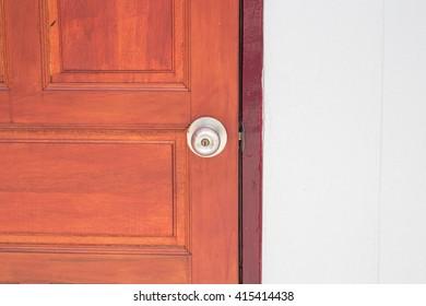 Aluminum door knob on the white door skin.