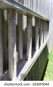 Aluminum Garden Ladder on backyard fence with soft focus background