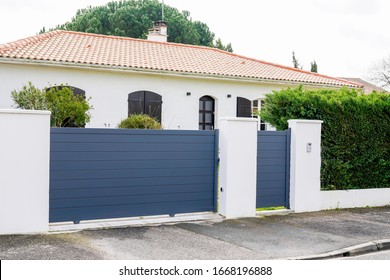 Aluminum gray gate and portal of suburb house