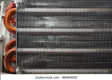 Aluminum heat exchanger with copper pipes