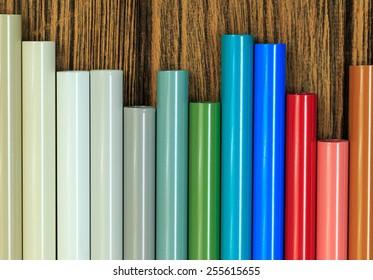 Aluminum profiles coated with powder coating on wooden background