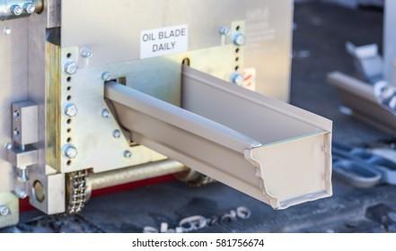 Aluminum Rain Gutter Feeding Through Seamless Shaping Machine.