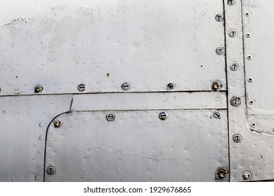 aluminum sheets joined together by welding and riveting, close-up of part of the outer skin of the fuselage of the aircraft