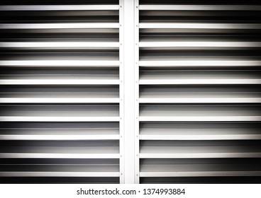 Aluminum shutter door with horizontal pattern. slide and louvers door background