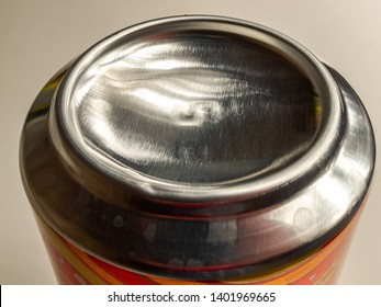 aluminum soda and beer beverage can with water droplets on light background, metal can, recyclable product, bottom view