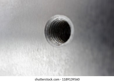 Aluminum threaded hole. The surface of aluminum with anodized surface.
