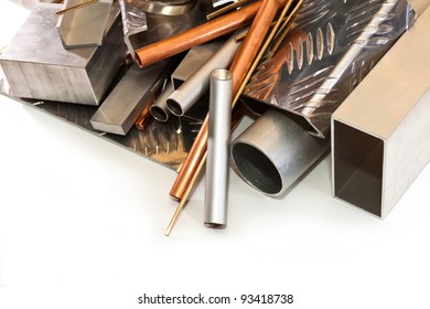 aluminum tubes, profiles, angles, copper and bronze wire on white background