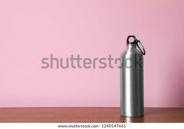 Aluminum water bottle for sports on color background. Space for text