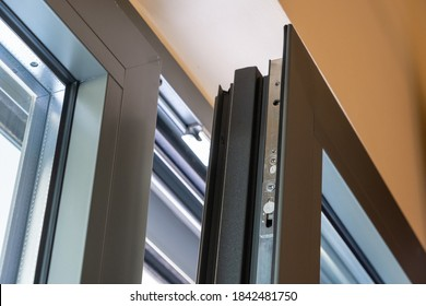 Aluminum window detail. Metal door frame open closeup view. Energy efficient, safety profile, blur background