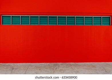 Aluminum window on Red Walls
