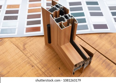 aluminum window with sample,color samples, isolated on wooden table