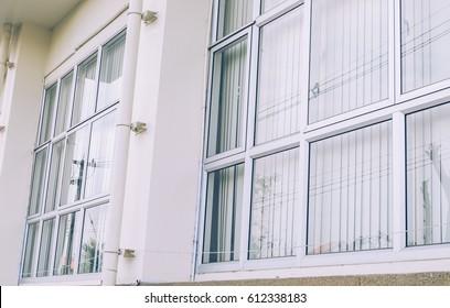 Aluminum windows.,Background.,Retro tone photo style.
