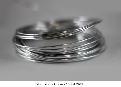 Aluminum wire on gray background