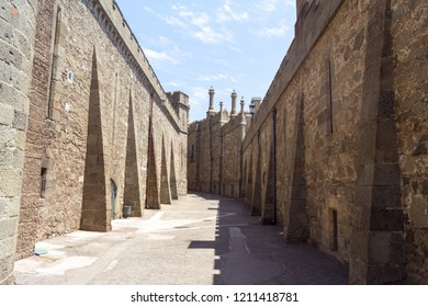 Alupka, Crimea - June 25, 2018: Stone walls on the way to the building of the Vorontsov Palace
