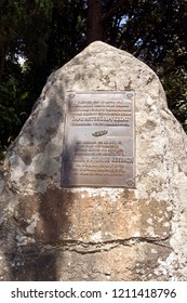 Alupka, Crimea - June 25, 2018: Stone with a sign about the creation of Alupka Park. The inscription in Russian with translation