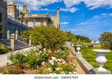 Alupka, Crimea - May 20, 2016: Vorontsov Palace with a beautiful flower garden in Crimea, Russia. Vorontsov Palace is a tourist attraction of Crimea. Historical architecture of Crimea in summer.