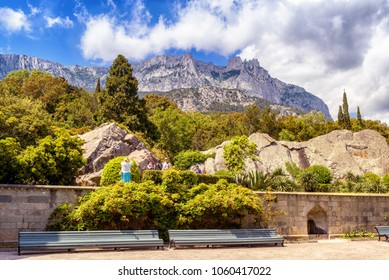Alupka, Crimea - May 20, 2016: Garden at the Vorontsov Palace in Crimea, Russia. It is one of the main tourist attractions of Crimea. Ai-Petri in the distance. Beautiful panoramic view of Crimea coast