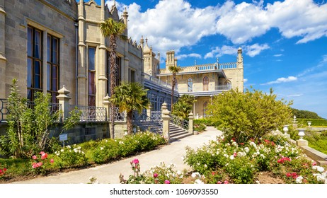 Alupka, Crimea - May 20, 2016: Vorontsov Palace with a flower garden in Crimea, Russia. Vorontsov Palace is one of the best-known sights in Crimea. Historical architecture of Crimea in summer.