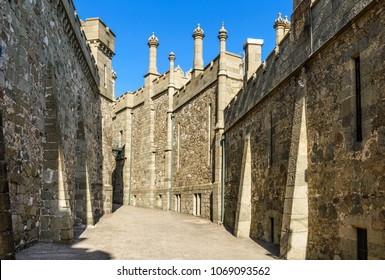Alupka, Crimea - May 20, 2016: Shuvalov Passage at the Vorontsov Palace in Crimea, Russia. Vorontsov Palace is one of the main attractions of Crimea. Old vintage stone alley between fortress walls.
