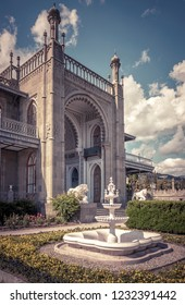 Alupka, Crimea - May 20, 2016: Vorontsov Palace with a fountain in Crimea, Russia. It is one of the main tourist attractions of Crimea. Vintage view of the old Crimea landmark in an arabic style.