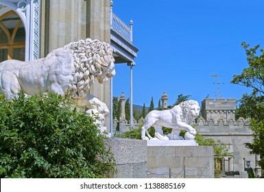 Alupka, Russia - 8 Sep 2016: Pair of marble lions with balls at southern facade of Vorontsov Palace.