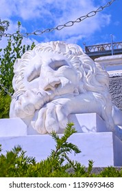 Alupka, Russia - 8 Sep 2016: Famous marble statue of sleeping lion at southern facade of Vorontsov Palace. Closeup