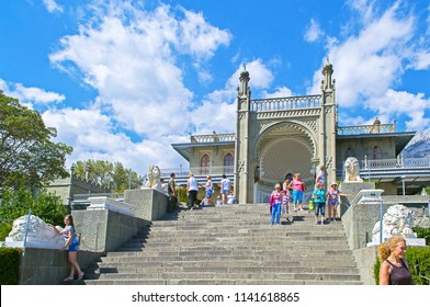 Alupka, Russia - 8 Sep 2016: Southern facade of Vorontsov Palace with 'Lions' terrace against picturesque blue sky with clouds.