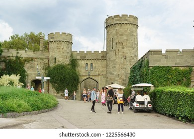 Alupka, Yalta, Crimea, Russia-September 08, 2018: Tourists near the Western entrance of the Palace built from diabase count Vorontsov in the resort village