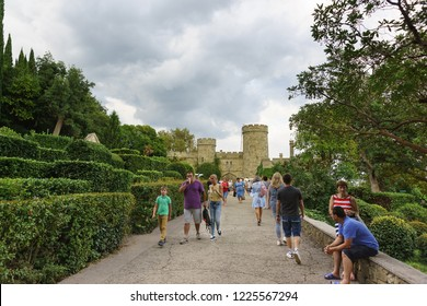 Alupka, Yalta, Crimea, Russia-September 08, 2018: Tourists walk along the pedestrian street Palace highway leading to the residence of count Vorontsov of the early 19th century