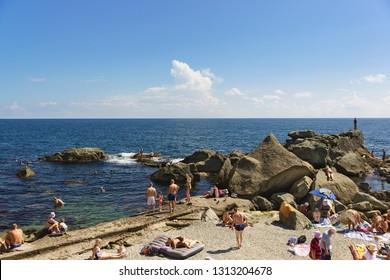 Alupka, Yalta, Crimea, Russia-September 12, 2018: top view of the popular children's beach. Calm Black sea
