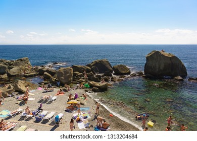 Alupka, Yalta, Crimea, Russia-September 12, 2018: top view of the popular picturesque children's beach. Large rocks to protect from wind and waves