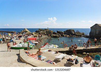Alupka, Yalta, Crimea, Russia-September 12, 2018: popular with tourists picturesque children's beach. Large rocks to protect from wind and waves