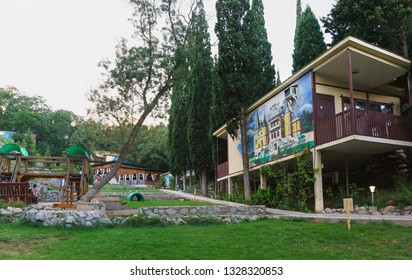 """Alupka, Yalta, Crimea, Russia-September 12, 2018: Landscaped area of the reconstructed hotel complex """"Green Cape"""" in the resort city. Children's Playground near the hotel buildings"""