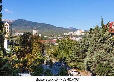 ALUSHTA, CRIMEA - SEPTEMBER 24, 2017: view of Baglikova Street in Alushta city in autumn day. Alushta is seaside resort town on southern coast of the Crimean peninsula.